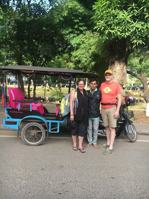 Premiere Travel Planners - Deb and Michael with Mr. Sarom in Cambodia